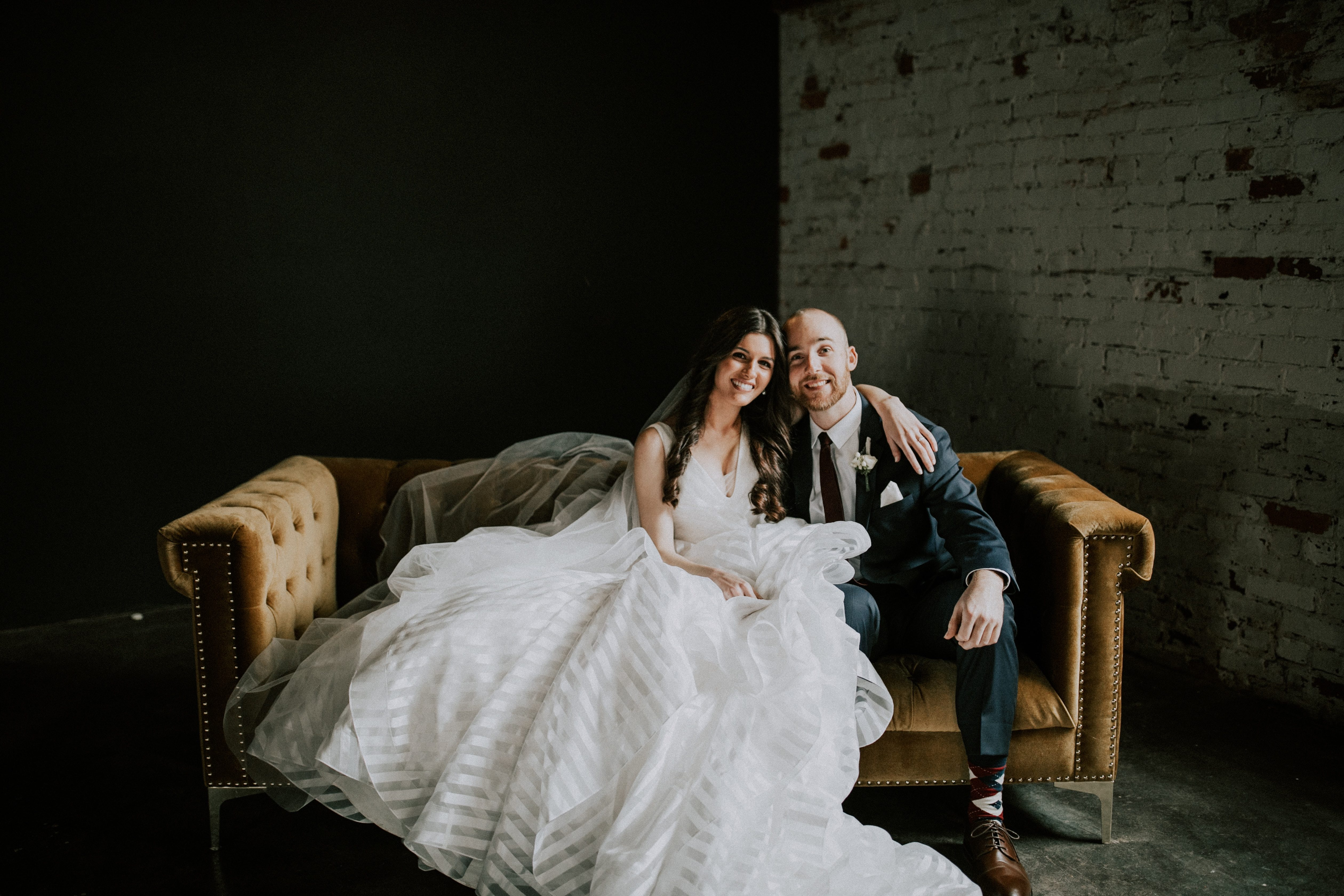 Newlyweds sitting on a couch